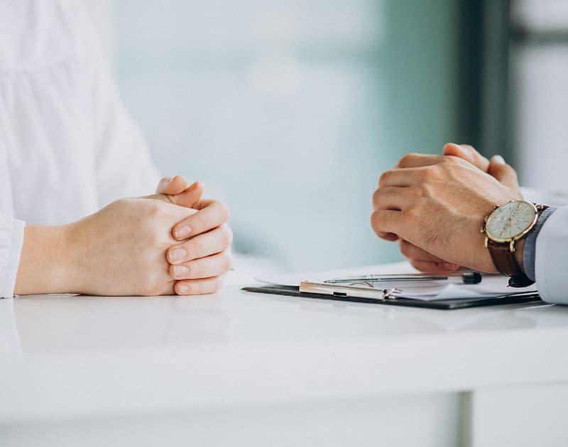 hands on desk in medical consultation