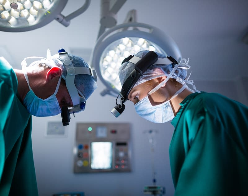 image of two surgeons performing microvascular surgery