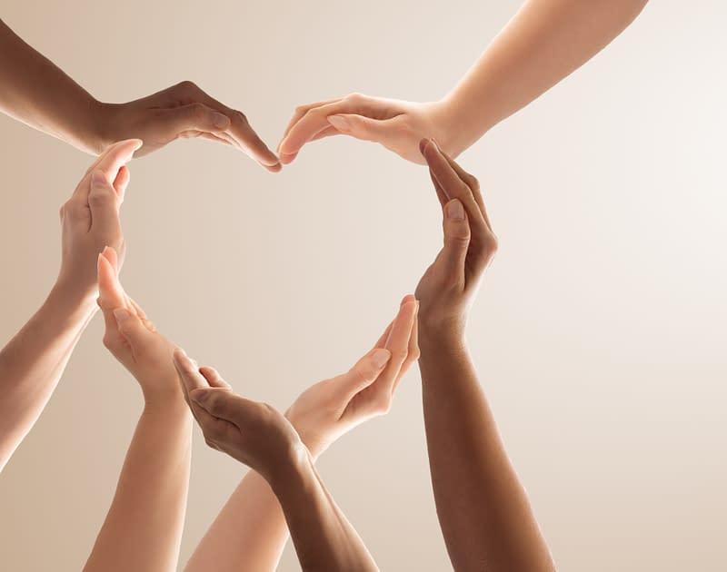 diverse hands make heart shape