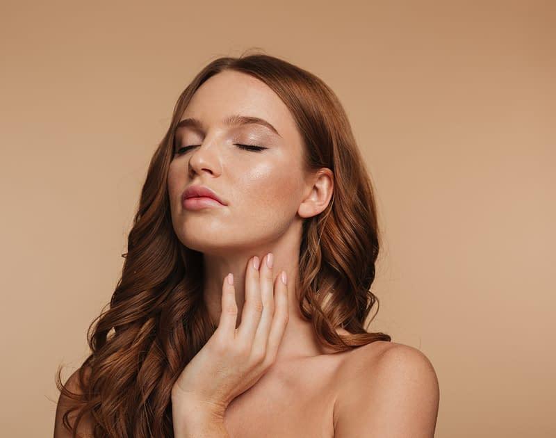 beautiful woman touching her neck