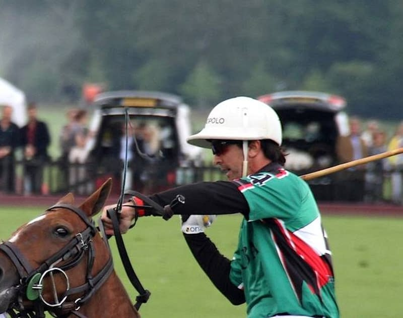 man rides horse in polo match