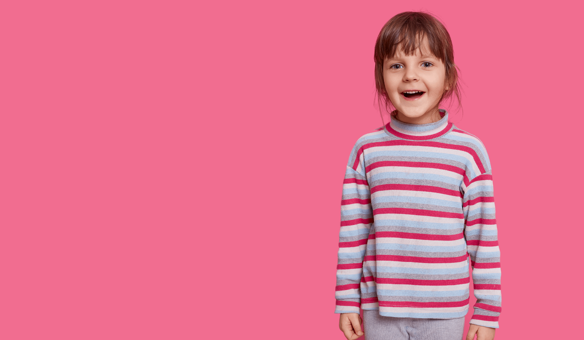 young female child smiling happily